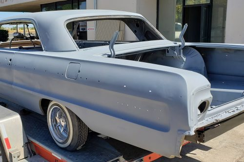 Chevy Impala abrasive blasted and primer coated for new paint in Sacramento