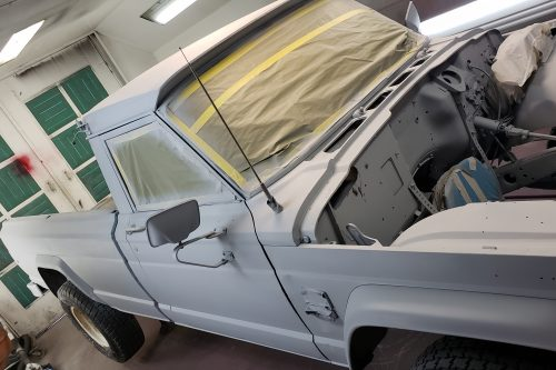 Truck media blasted and primed for paint