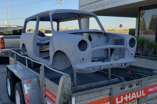 Mini auto body frame after abrasive blasting and primer coating